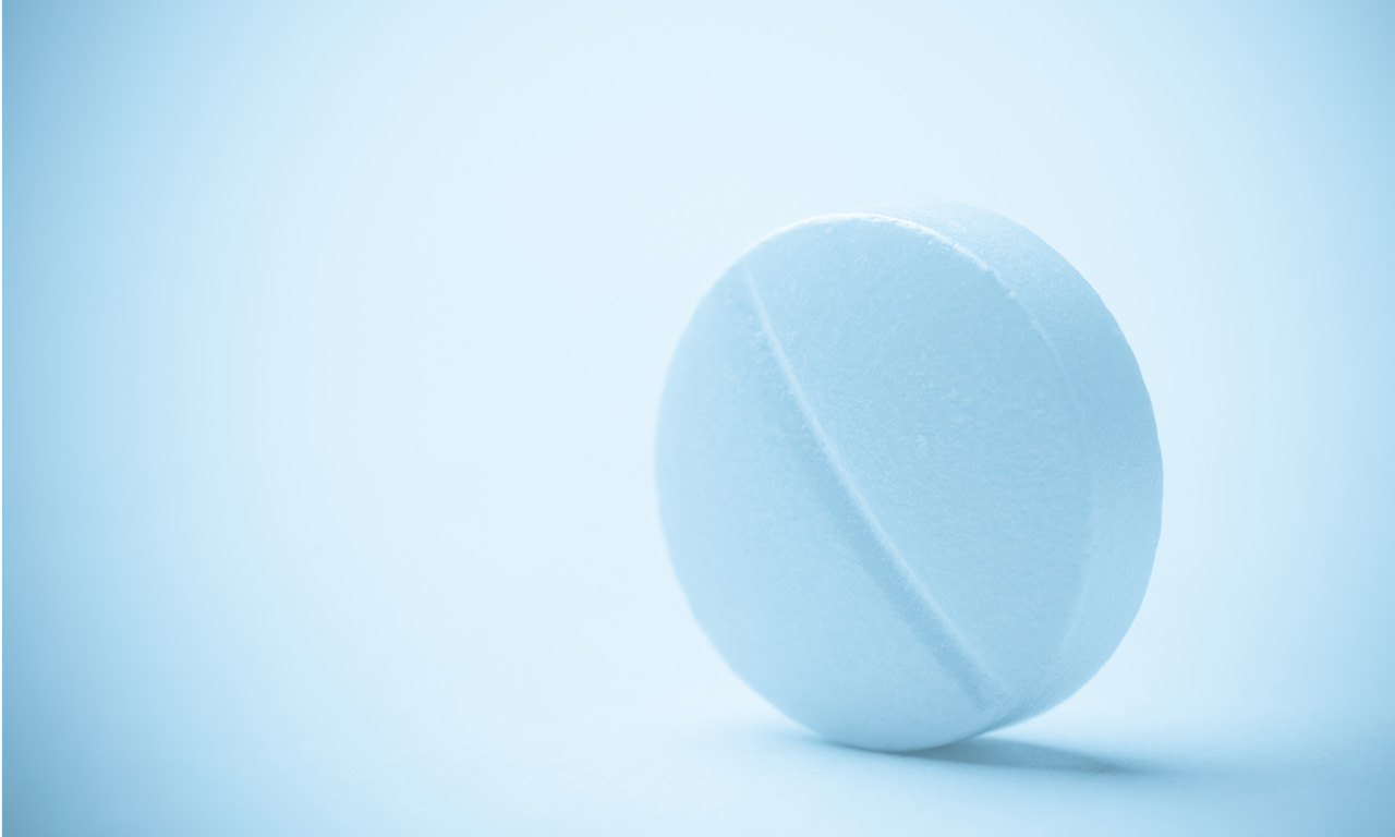 white scored tablet
