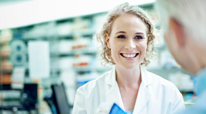 female pharmacist with patient