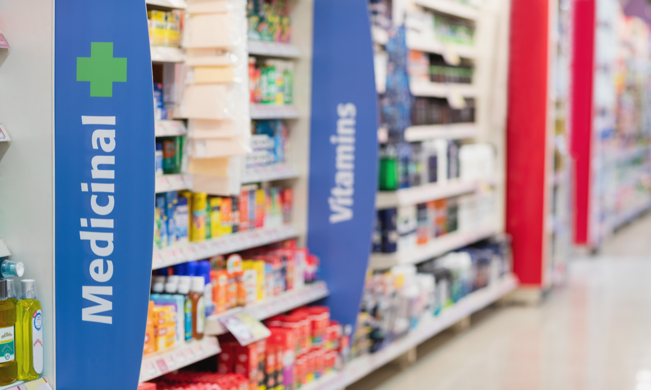pharmacy shelves showing medicines and vitamins