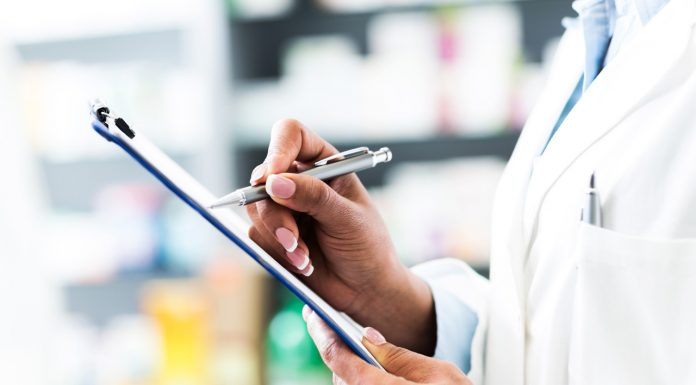 pharmacist holding clipboard and pen