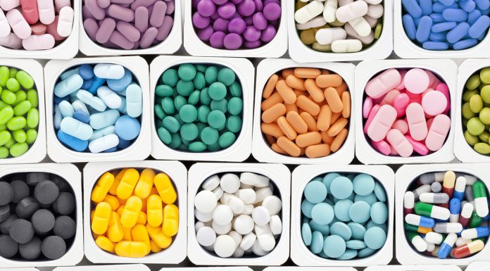colourful medications sorted into cups