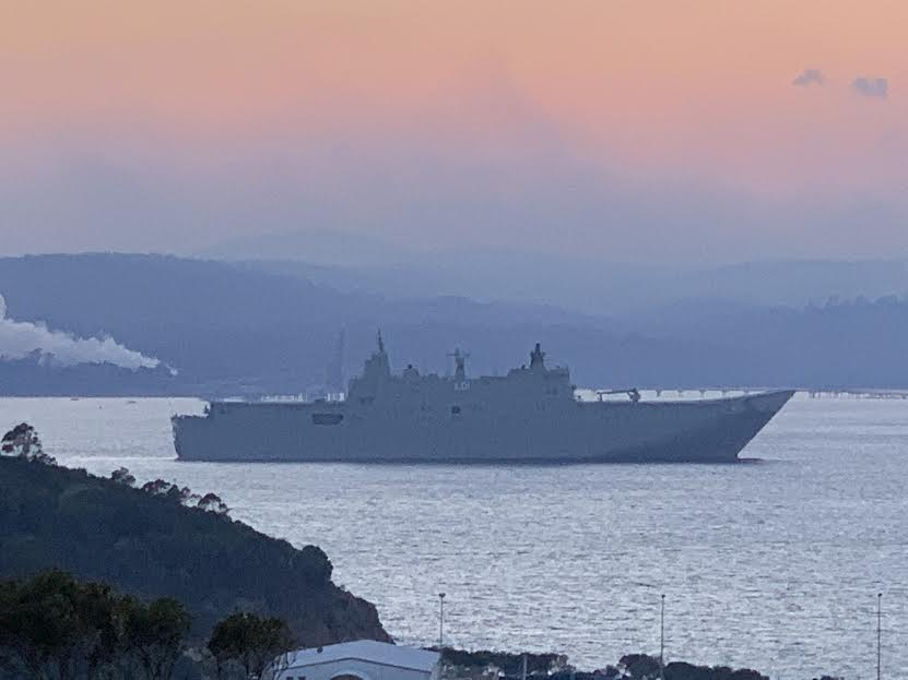 HMAS Adelaide leaves Eden Harbour this week as fire threat abates. Photo credit: Eden Pharmacy