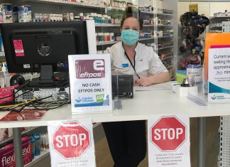 A triage desk at Capital Chemist Southlands prevents customers from entering the pharmacy