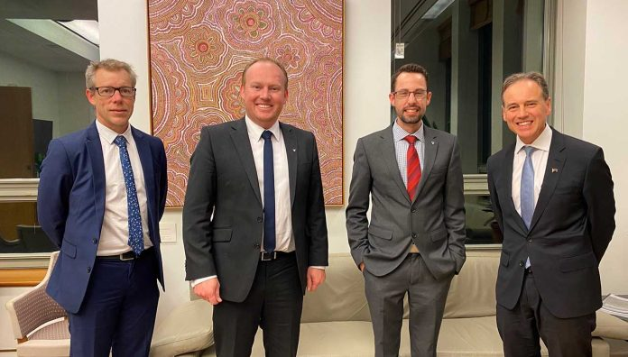 PSA's lead 7CPA negotiator Dr Shane Jackson, CEO Mark Kinsella and National President Associate Professor Chris Freeman with Federal Health Minister Greg Hunt.