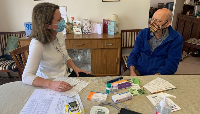 Accredited pharmacist Kay Morey MPS conducting a Home Medicine Review during Stage 3 lockdown.