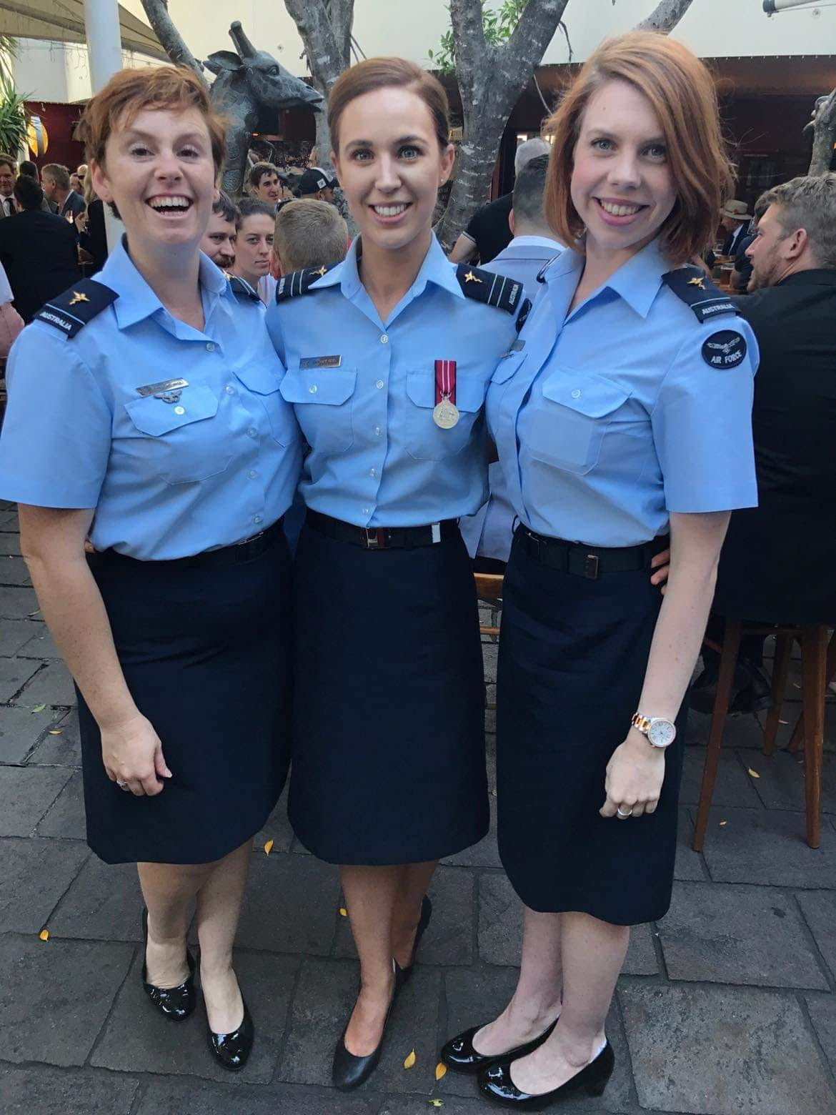 FLTLT Jones (right) with colleagues after the 2018 Anzac Day march in Brisbane.