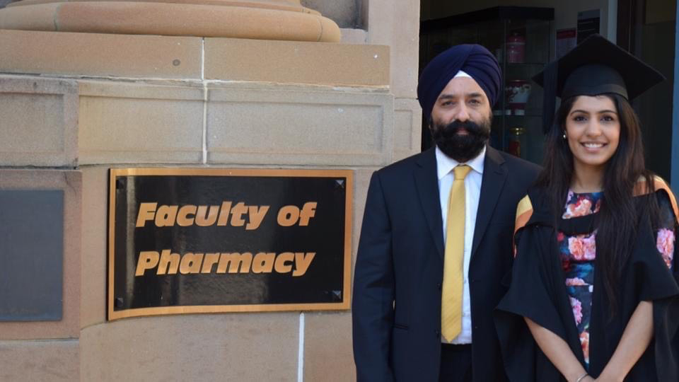 Depinder Chhibber MPS with her dad after graduating from the University of Sydney.