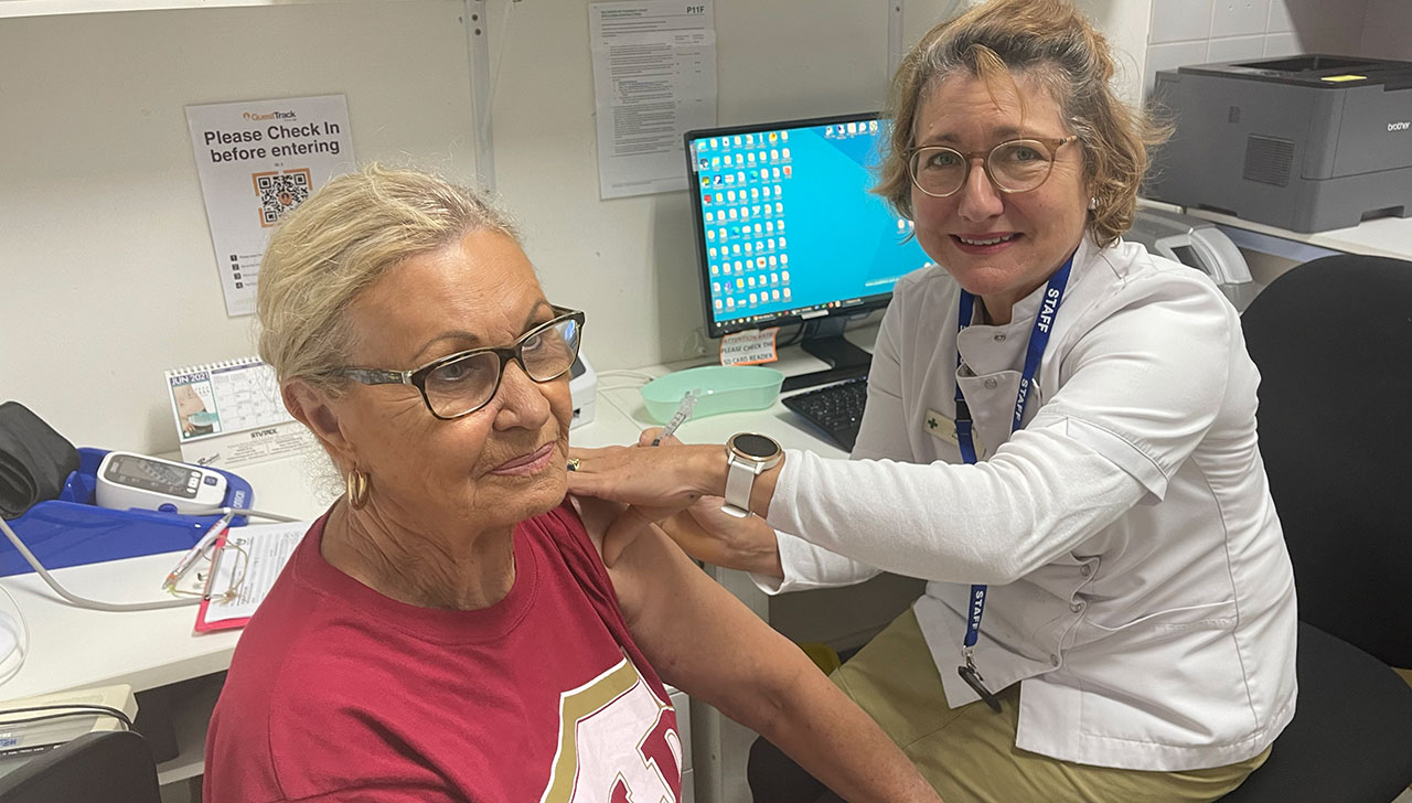 Pharmacist Sarah Parry-Okeden vaccinating a patient at Acton Health Pharmacy