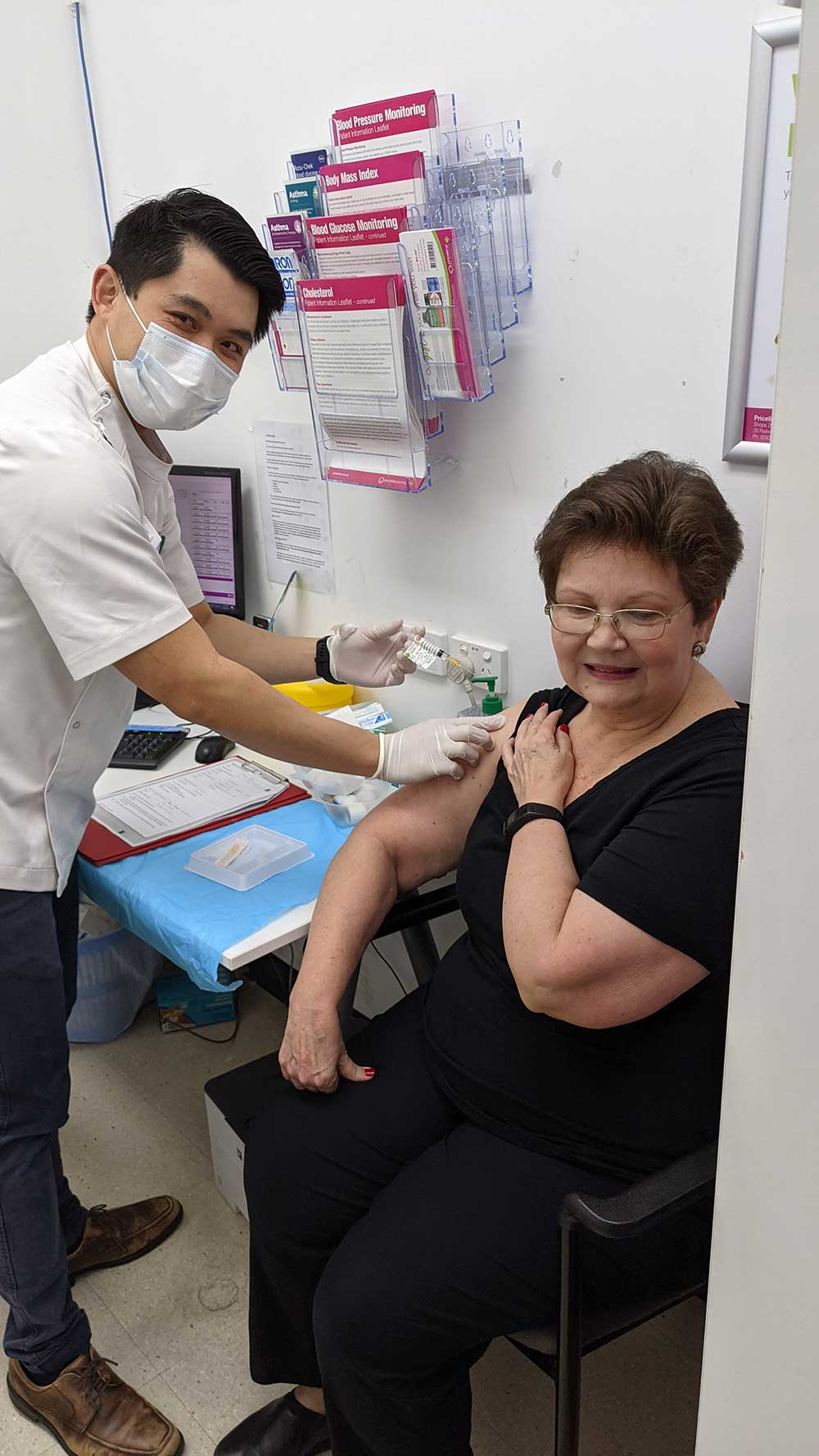 Perth pharmacist Mr Wong vaccinating a patient